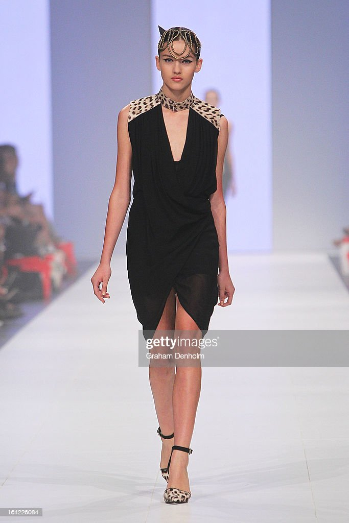 A model showcases designs by Kirrily Johnston on the runway at the L'Oreal Paris Runway 4 show during day four of L'Oreal Melbourne Fashion Festival...
