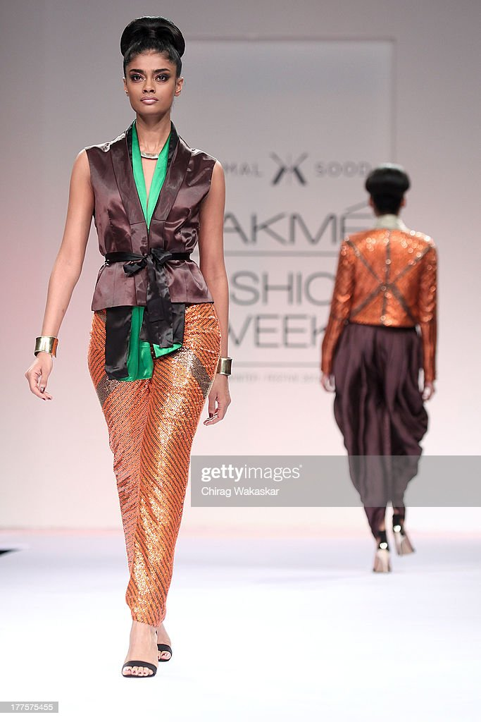 A model showcases designs by Kommal Sood on the runway during day 2 of Lakme Fashion Week Winter/Festive 2013 at the Hotel Grand Hyatt on August 24, 2013 in Mumbai, India.