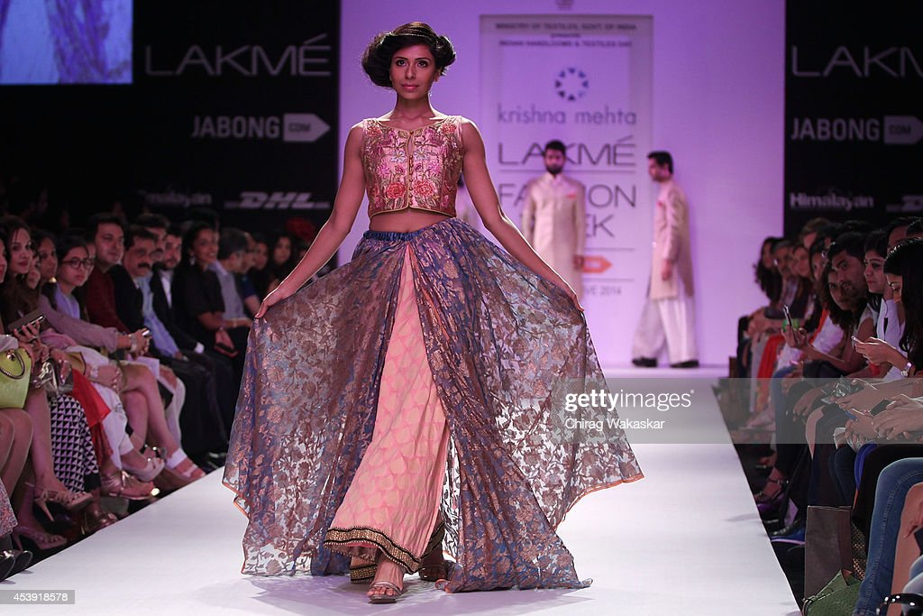 A model showcases designs by Krishna Mehta during day 2 of Lakme Fashion Week Winter/Festive 2014 at The Palladium Hotel on August 21, 2014 in Mumbai, India.