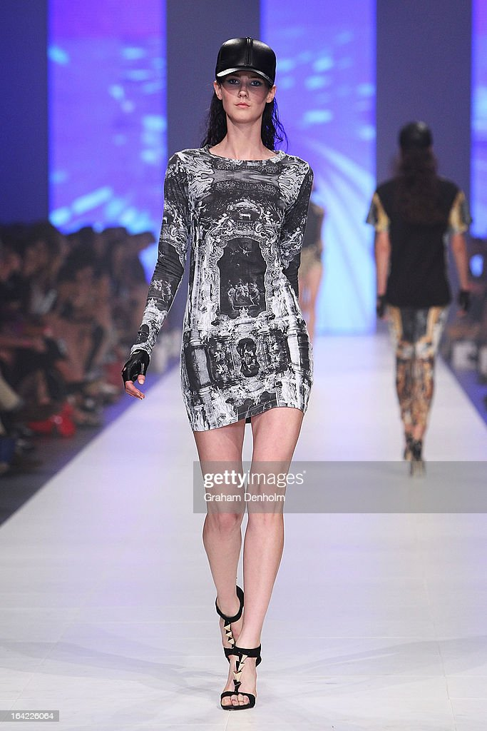 A model showcases designs by Ksubi on the runway at the L'Oreal Paris Runway 3 show during day four of L'Oreal Melbourne Fashion Festival on March 21...