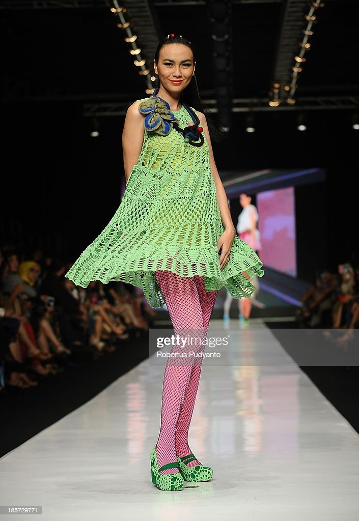 A model showcases designs by Lenni Agustin on the runway at the Body Shop show during Jakarta Fashion Week 2014 at Senayan City on October 24, 2013 in Jakarta, Indonesia.