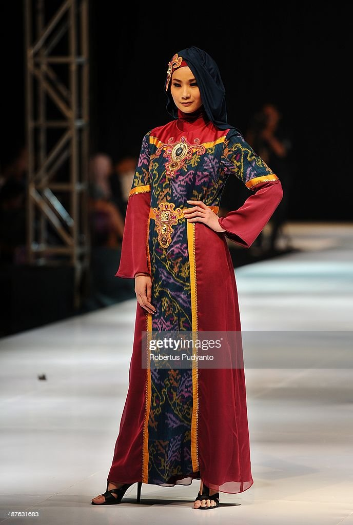 A model showcases designs by Lia Afif on the runway at Fearless Beauty show during The 7th Surabaya Fashion Parade 'NIWASANA NUSANTARA 2014' at Tunjungan Plaza on on May 1, 2014 in Surabaya, Indonesia.