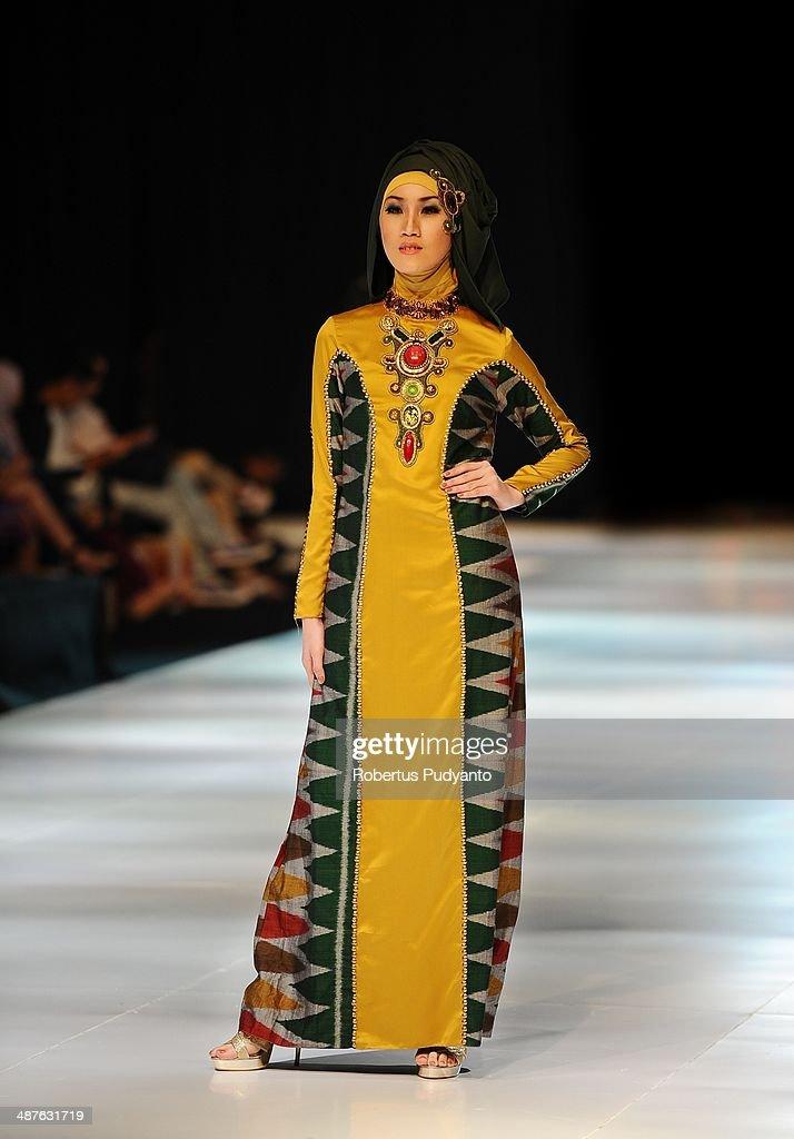 A model showcases designs by Lia Afif on the runway at Fearless Beauty show during The 7th Surabaya Fashion Parade 'NIWASANA NUSANTARA 2014' at Tunjungan Plaza on on May 1, 2014 in Surabaya, Indonesia.