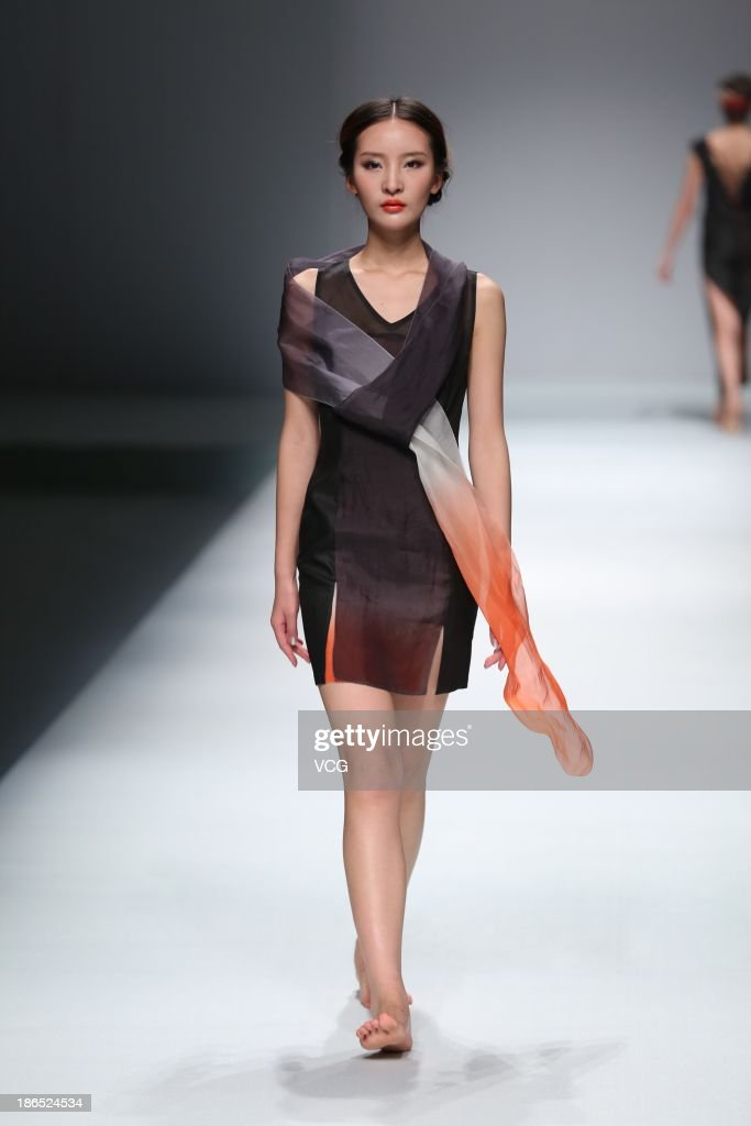 A model showcases designs by Liang Zi on the runway at the TANGY Liangzi Collection show during Mercedes-Benz China Fashion Week Spring/Summer 2014 at Beijing Hotel on October 31, 2013 in Beijing, China.