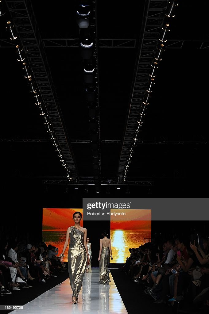 A model showcases designs by Liliana Lim on the runway at the Indonesian Fashion Designer Council show during Jakarta Fashion Week 2014 at Senayan City on October 21, 2013 in Jakarta, Indonesia.