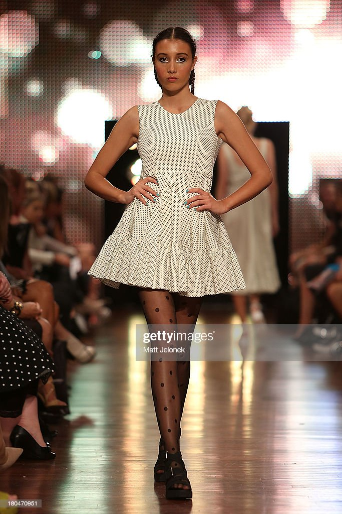 A model showcases designs by Little Gracie on the runway during Perth Fashion Festival at The Western Australian Museum on September 13, 2013 in Perth, Australia.