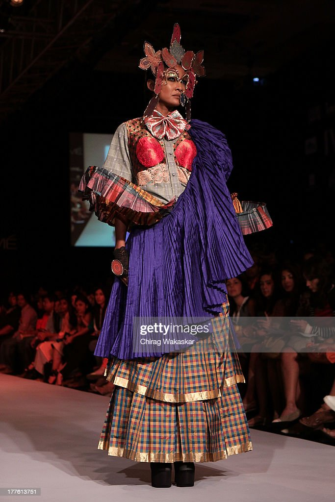 A model showcases designs by Little Shilpa on the runway during day 2 of Lakme Fashion Week Winter/Festive 2013 at the Hotel Grand Hyatt on August 24, 2013 in Mumbai, India.