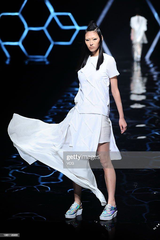 A model showcases designs by Lu Shengqia on the runway at the Asahi Kasei Chinese Fashion Designer Creativity Award - Lu Shengqian Collection show during Mercedes-Benz China Fashion Week Spring/Summer 2014 at Beijing Hotel on October 27, 2013 in Beijing, China.