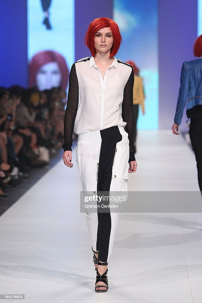 A model showcases designs by Lucette on the runway at the L'Oreal Paris Runway 6 show during day five of L'Oreal Melbourne Fashion Festival on March...