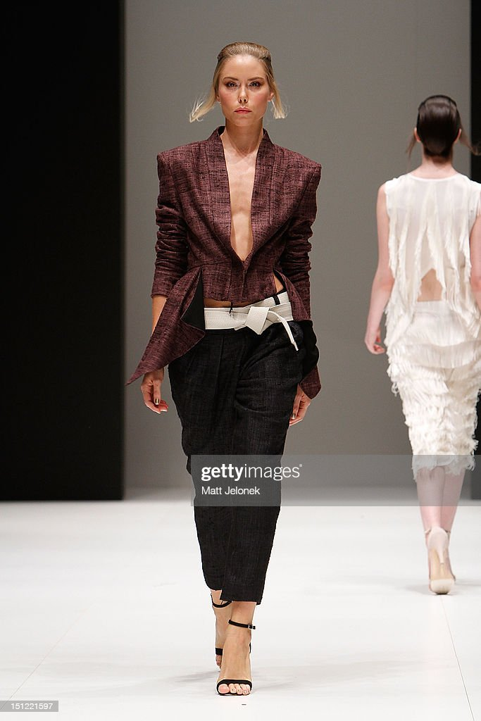 A model showcases designs by Lui Hon on the catwalk on day 2 of Melbourne Spring Fashion Week 2012 at Melbourne Town Hall on September 4, 2012 in Melbourne, Australia.