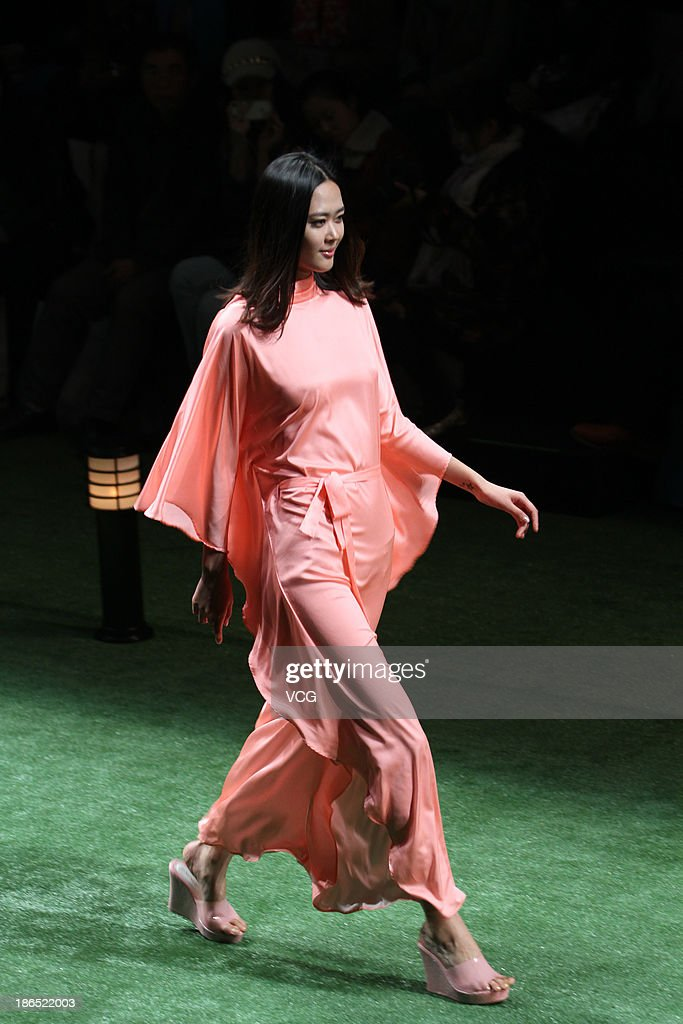 A model showcases designs by Ma Bin on the runway at the LA NOUVELLE FAMILLE Ma Bin Home Wear Collection show during Mercedes-Benz China Fashion Week Spring/Summer 2014 at 751 D.PARK Workshop on October 31, 2013 in Beijing, China.