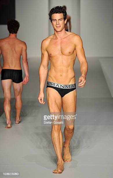 A model showcases designs by Man and Woman by Peter Morrissey on the catwalk during the Man And Woman by Peter Morrissey Dr Rey's Shapewear and...