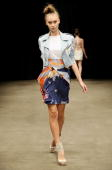 A model showcases designs by Manning Cartell on the catwalk at the Overseas Passenger Terminal Circular Quay on day two of Rosemount Australian...