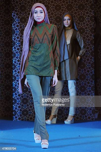 A model showcases designs by Marrakech on the runway during Blissful Ramadan Fashion Show at Ciputra World on June 21 2015 in Surabaya Indonesia...