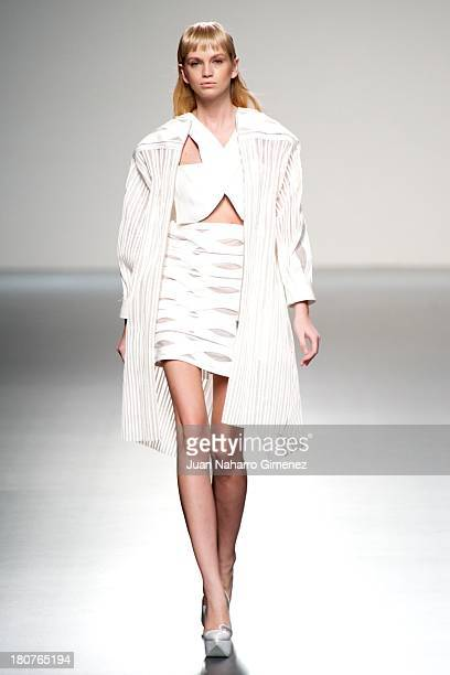 A model showcases designs by Martin Lamothe on the runway at Martin Lamothe show during Mercedes Benz Fashion Week Madrid Spring/Summer 2014 at Ifema...