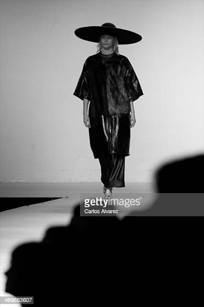 A model showcases designs by Martin Lamothe on the runway at Martin Lamothe show during Mercedes Benz Fashion Week Madrid Fall/Winter 2014 at Ifema...