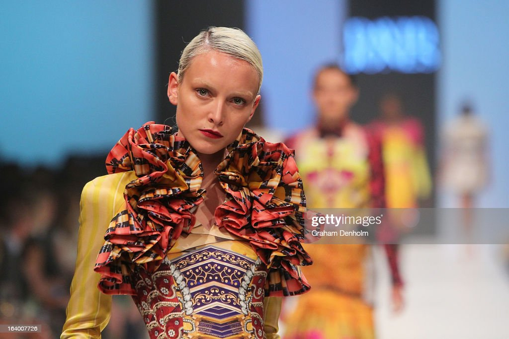 A model showcases designs by Mary Katrantzou during the L'Oreal Melbourne Fashion Festival Opening Event presented by David Jones at Docklands on March 19, 2013 in Melbourne, Australia.