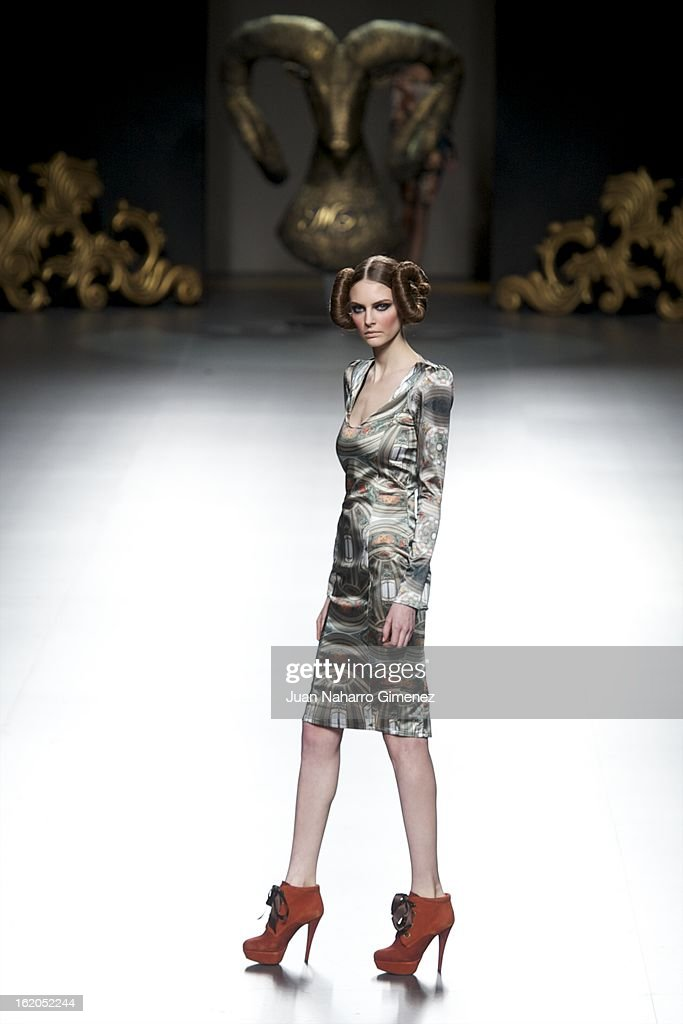 A model showcases designs by Maya Hansen on the runway during Mercedes Benz Fashion Week Madrid Fall/Winter 2013/14 at Ifema on February 18, 2013 in Madrid, Spain.