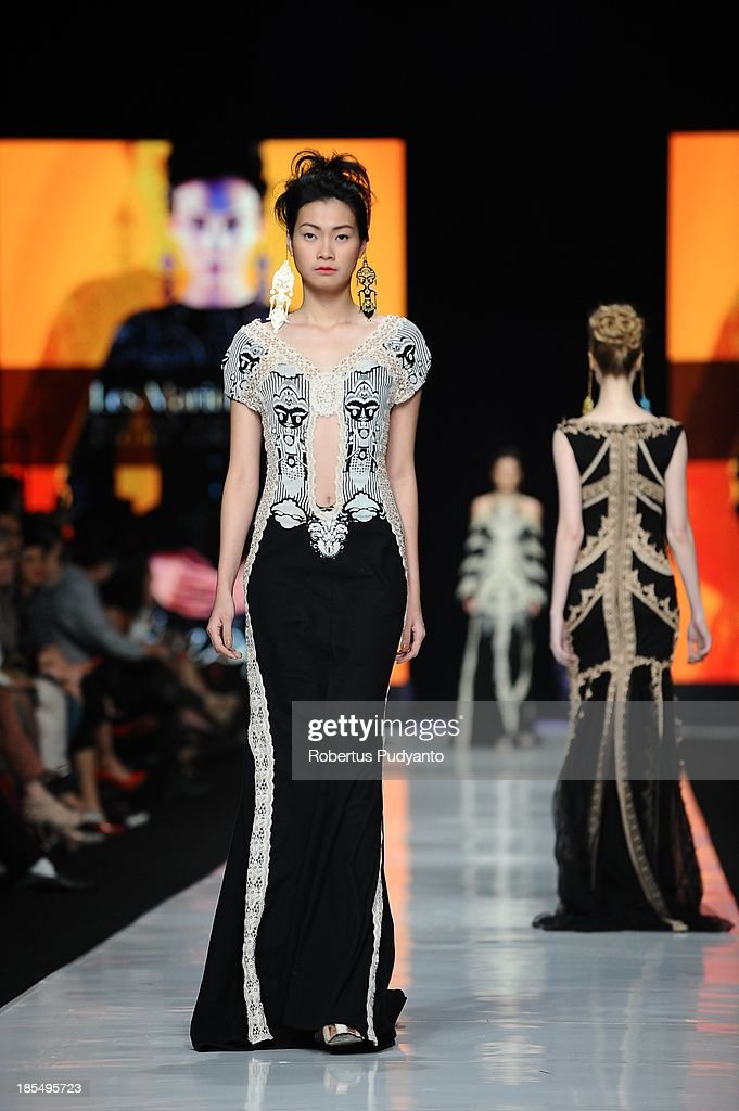 A model showcases designs by Mel Ahyar on the runway at the Indonesian Fashion Designer Council show during Jakarta Fashion Week 2014 at Senayan City on October 21, 2013 in Jakarta, Indonesia.