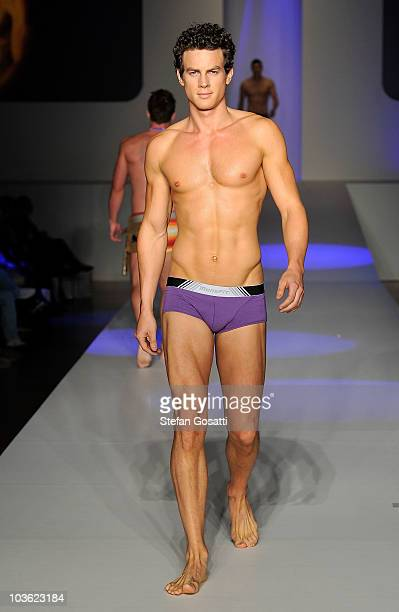 A model showcases designs by Mensfit on the catwalk during the Man And Woman by Peter Morrissey Dr Rey's Shapewear and Mensfit group show as part of...