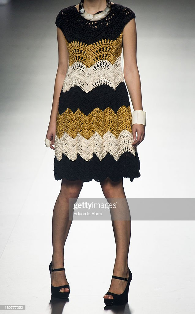 A model showcases designs by Merche Correa on the runway at Merche Correa show during Mercedes Benz Fashion Week Madrid Spring/Summer 2014 at Ifema on September 16, 2013 in Madrid, Spain.