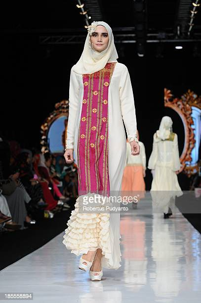 A model showcases designs by Merry Pramono on the runway at the Great Gatsby show during Jakarta Fashion Week 2014 at Senayan City on October 22 2013...