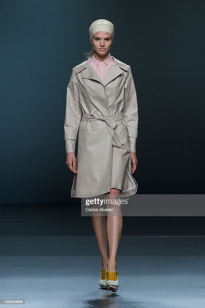 A model showcases designs by Moises Nieto on the runway at Moises Nieto show during Mercedes Benz Fashion Week Madrid Spring/Summer 2015 at Ifema on...