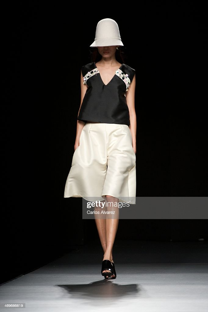 A model showcases designs by Moises Nieto on the runway at Moises Nieto show during Mercedes Benz Fashion Week Madrid Fall/Winter 2014 at Ifema on...