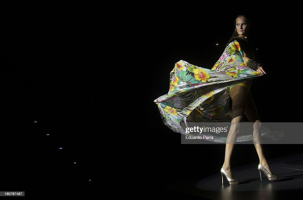 A model showcases designs by Montse Bassons on the runway at Montse Bassons show during Mercedes Benz Fashion Week Madrid Spring/Summer 2014 at Ifema on September 16, 2013 in Madrid, Spain.