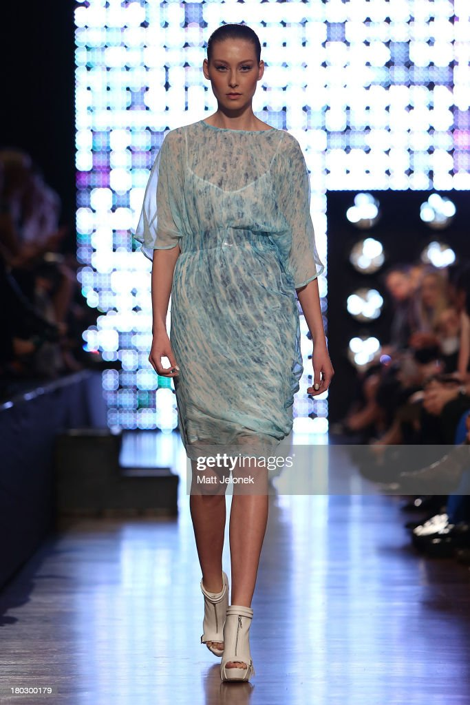 A model showcases designs by Morrison on the runway during Perth Fashion Festival at The Western Australian Museum on September 11, 2013 in Perth, Australia.