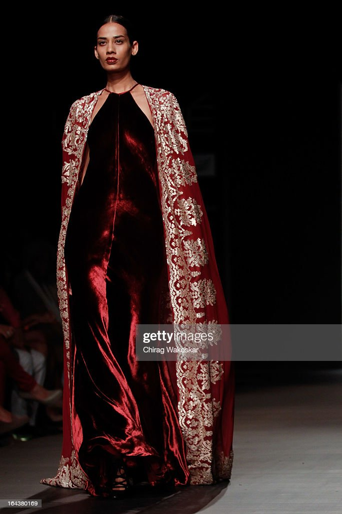 A model showcases designs by Naeem Khan on the runway during day two of the Lakme Fashion Week Summer/Resort 2013 on March 23, 2013 at Grand Hyatt in Mumbai, India.