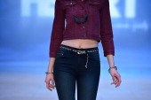 A model showcases designs by Nana Judy on the catwalk as part of Mercedes Benz Fashion Festival Sydney 2012 at Sydney Town Hall on August 23 2012 in...