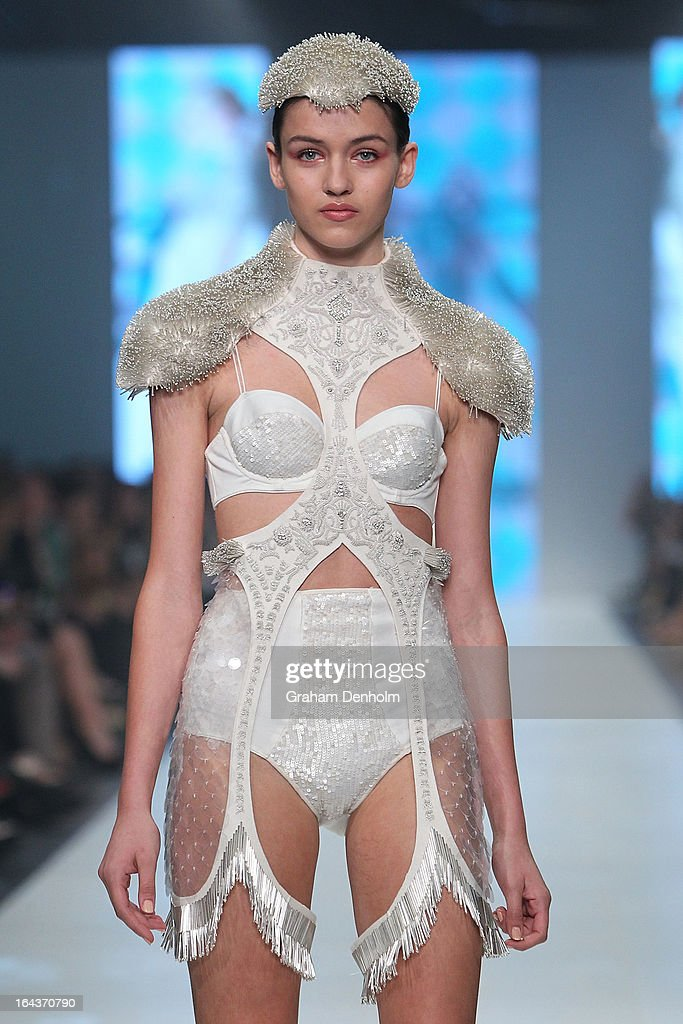 A model showcases designs by Natasha Fagg on the runway at the Sportsgirl National Graduate Showcase during day six of L'Oreal Melbourne Fashion Festival on March 23, 2013 in Melbourne, Australia.