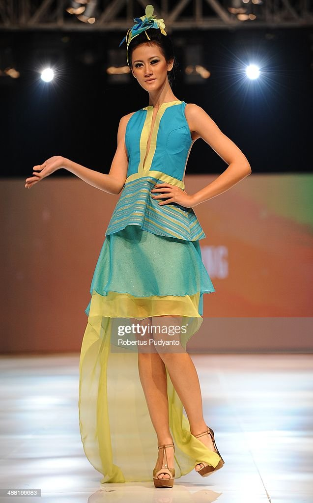 A model showcases designs by Oki Wong on the runway during The 7th Surabaya Fashion Parade 'NIWASANA NUSANTARA 2014' day four at Tunjungan Plaza on May 4, 2014 in Surabaya, Indonesia.