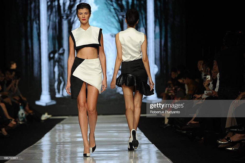 A model showcases designs by Patrick Owen on the runway at the Mazda Young Vibrant Designers show during Jakarta Fashion Week 2014 at Senayan City on October 24, 2013 in Jakarta, Indonesia.