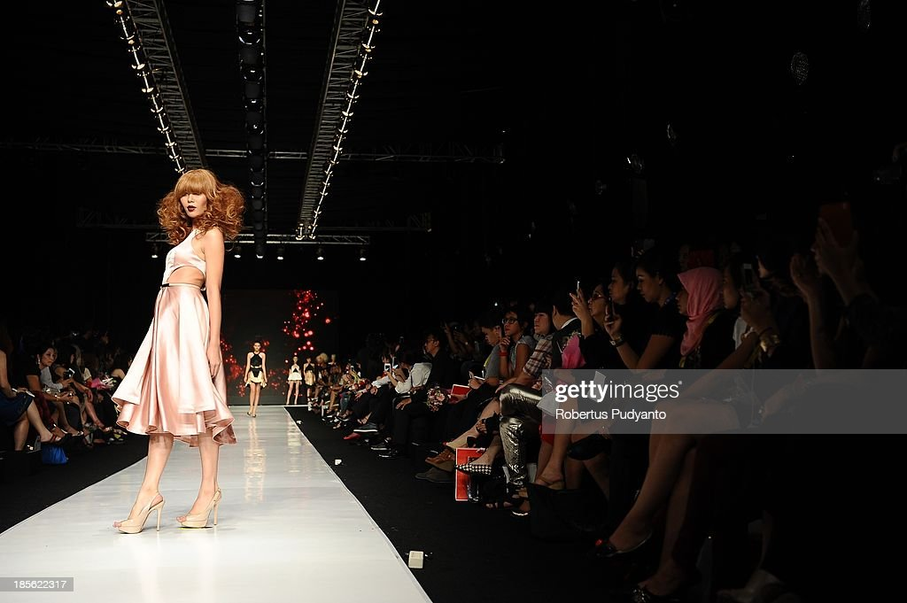 A model showcases designs by Peggy Hartato and hair by Nick Malenko on the runway at the It Looks Fall Winter 13/14 show during Jakarta Fashion Week 2014 at Senayan City on October 23, 2013 in Jakarta, Indonesia.
