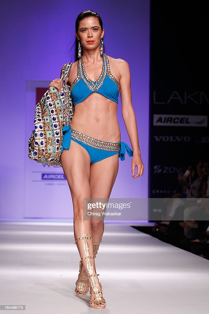 A model showcases designs by Pia Pauro on the runway during day two of the Lakme Fashion Week Summer/Resort 2013 on March 23, 2013 at Grand Hyatt in Mumbai, India.