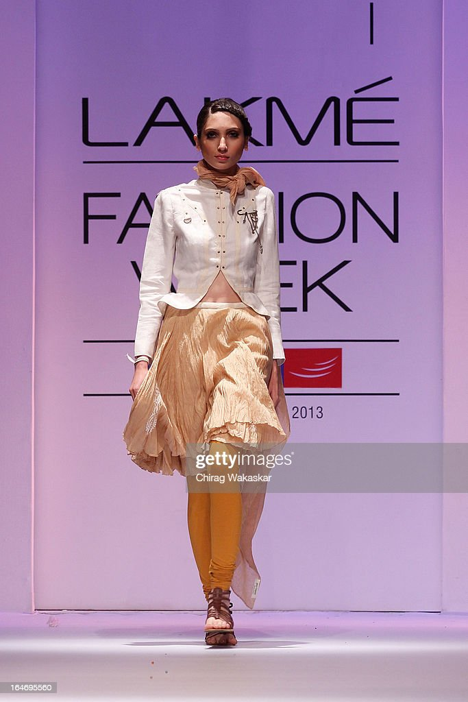 A model showcases designs by Pooja Kapoor on the runway during day five of Lakme Fashion Week Summer/Resort 2013 on March 26, 2013 at Grand Hyatt in Mumbai, India.