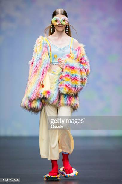 A model showcases designs by POURQUOI on the runway during the Designers' Collection Show 2 MACAO FASHION PARADE on the Day 2 of the CentreStage Hong...