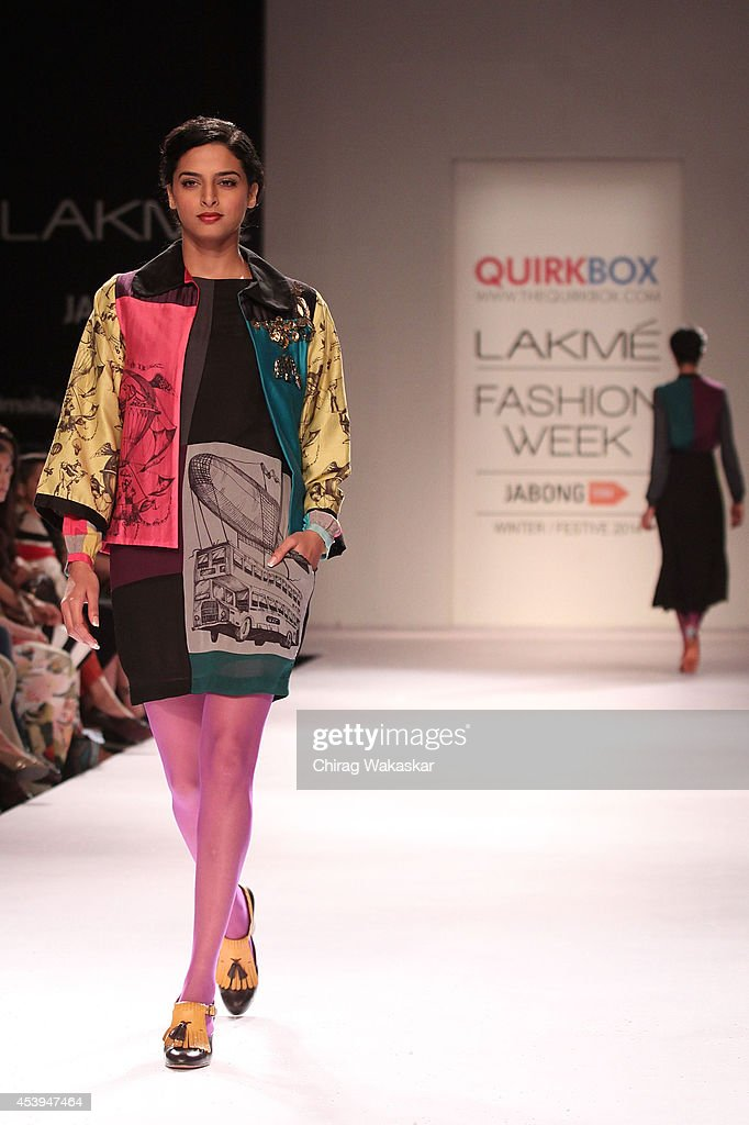 A model showcases designs by Quirk Box during day 3 of Lakme Fashion Week Winter/Festive 2014 at The Palladium Hotel on August 22, 2014 in Mumbai, India.