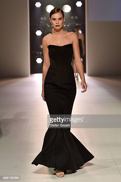 A model showcases designs by Rachel Gilbert during the Red Carpet runway show at MercedesBenz Fashion Festival Sydney at Sydney Town Hall on...