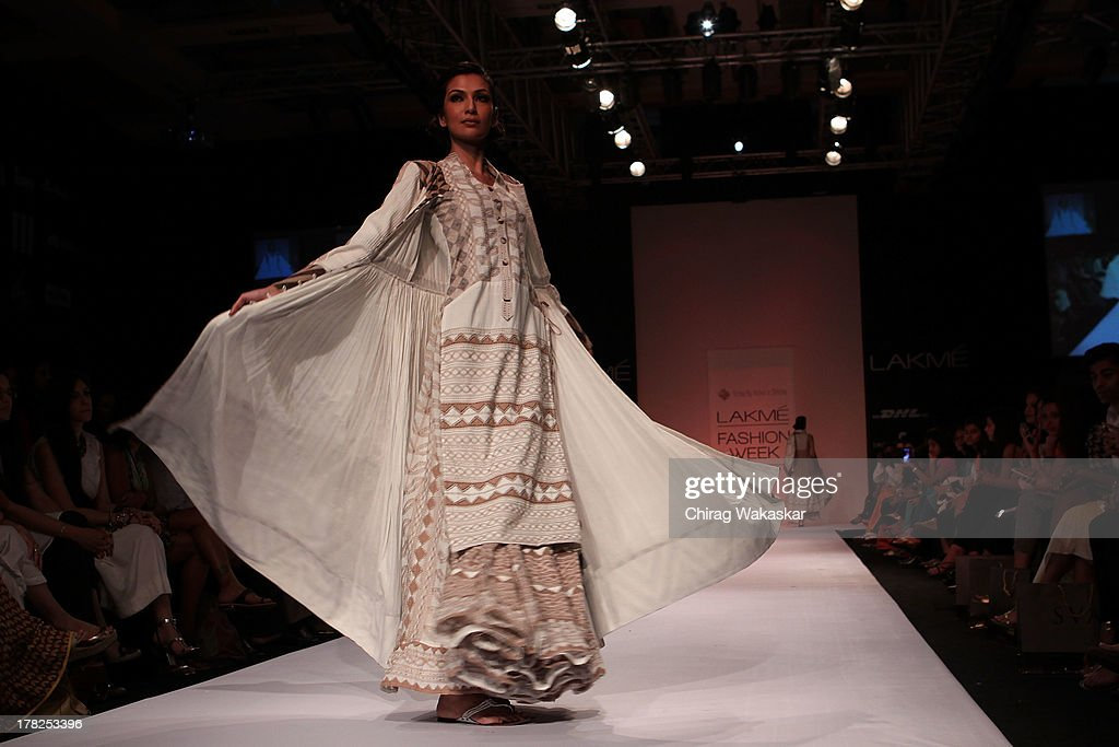A model showcases designs by Rahul & Shikha during day 5 of Lakme Fashion Week Winter/Festive 2013 at the Hotel Grand Hyatt on August 27, 2013 in Mumbai, India.