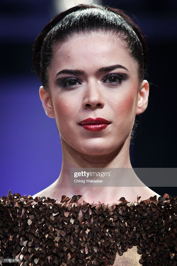 A model showcases designs by Rajat K Tangri on the runway during day 2 of Lakme Fashion Week Winter/Festive 2013 at the Hotel Grand Hyatt on August 24, 2013 in Mumbai, India.