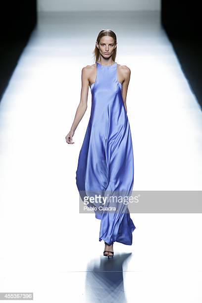 A model showcases designs by Roberto Torreta on the runway during Mercedes Benz Fashion Week Madrid Spring/Summer 2015 at Ifema on September 13 2014...