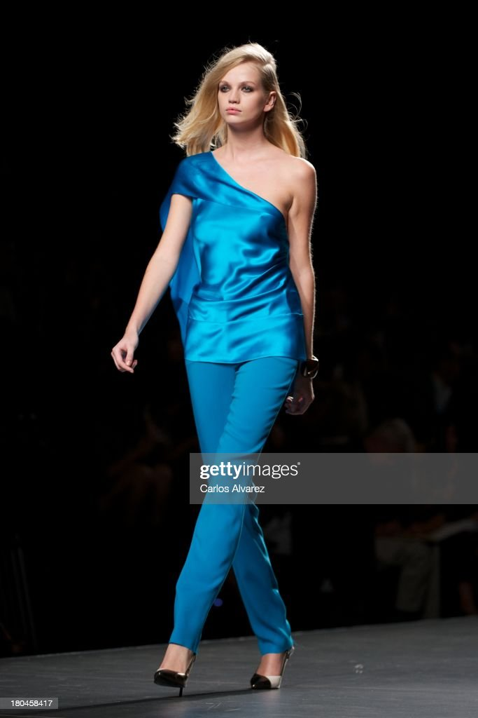 A model showcases designs by Roberto Torretta on the runway at Roberto Torretta show during Mercedes Benz Fashion Week Madrid Spring/Summer 2014 at Ifema on September 13, 2013 in Madrid, Spain.