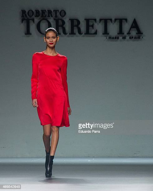 A model showcases designs by Roberto Torretta on the runway at Roberto Torretta show during Mercedes Benz Fashion Week Madrid Fall/Winter 2014 at...