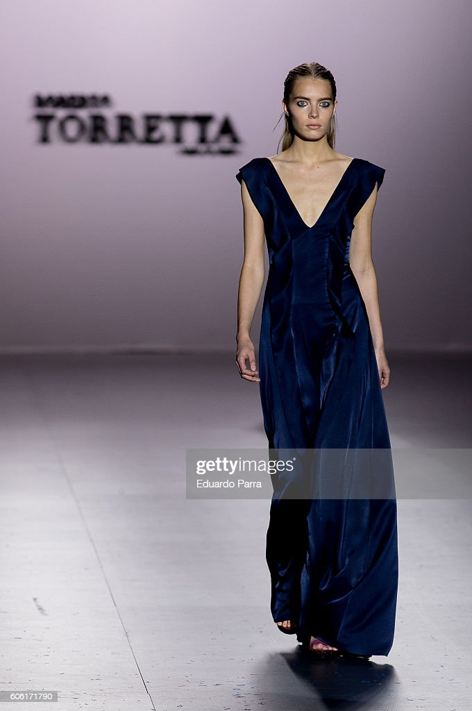 model-showcases-designs-by-roberto-torretta-on-the-runway-at-the-picture-id606171790