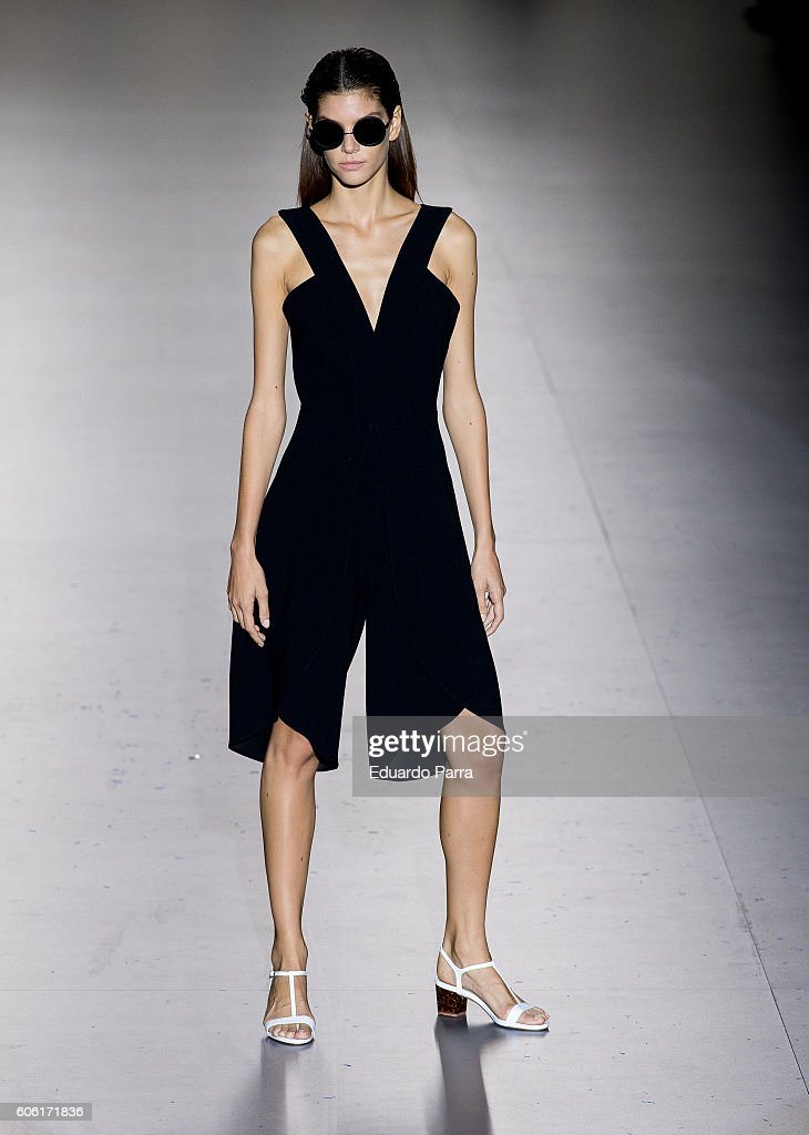 model-showcases-designs-by-roberto-torretta-on-the-runway-at-the-picture-id606171836
