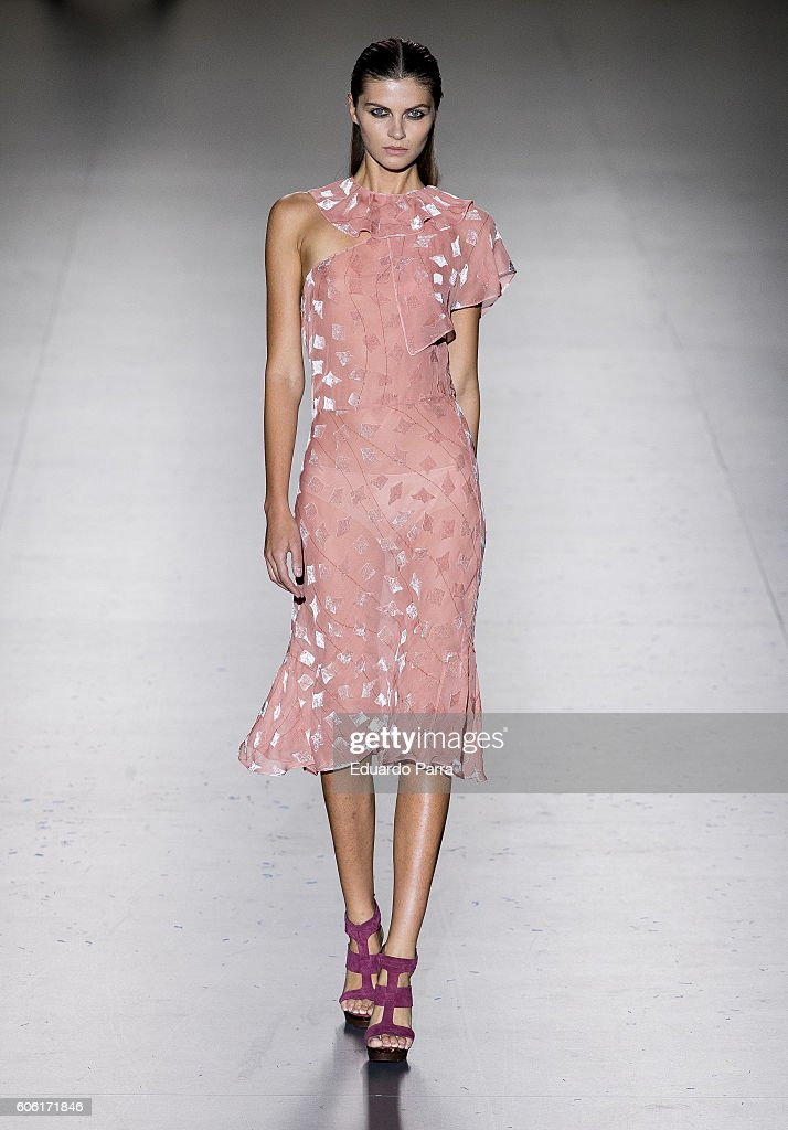 model-showcases-designs-by-roberto-torretta-on-the-runway-at-the-picture-id606171846