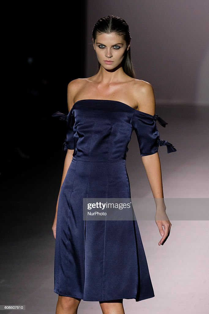 model-showcases-designs-by-roberto-torretta-on-the-runway-at-the-picture-id606507510